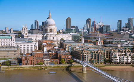 London, UK - 1 October, 2019: St. Pauls cathedral and City of London view including river Thames and Millennium bridge in early morning.