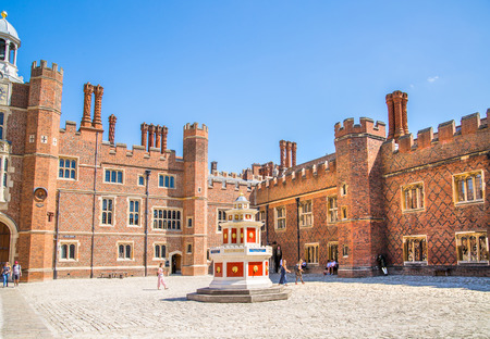 London, UK - July 29, 2019: English architecture of Tudors time, inner court of Hampton house, locates in West London