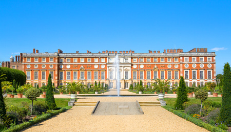 London, UK - July 29, 2019: English garden view and the East Front of Hampton court 17th century locates West London