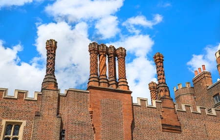London, UK - July 29, 2019: English architecture, chimneys. Inner court of Hampton house, locates in West London Editorial