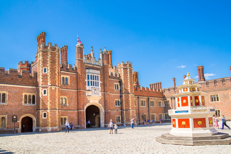 London, UK - July 29, 2019: English architecture Tudors time, West Front of Hampton court with entrance gate, locates in West London
