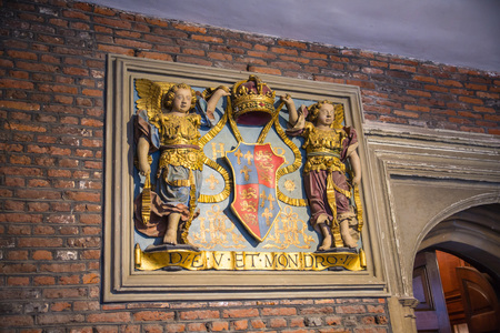 London, UK - July 29, 2019:  Arms on the entry of Hampton court chapel, belonged to Henry VIII. Locates in West London.