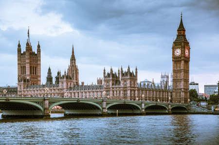 LONDON, UK - June 24, 2019 - Big Ben, Houses of Parliament and Westminster bridge on Thames river.