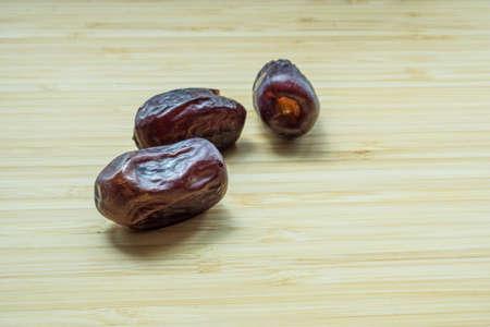 Kurma or dates on wooden board