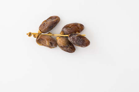Kurma or dates isolated on white background Stock Photo