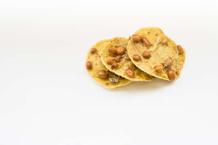 Traditional Malaysian cookies snack called Kuih Rempeyek over white background Banco de Imagens