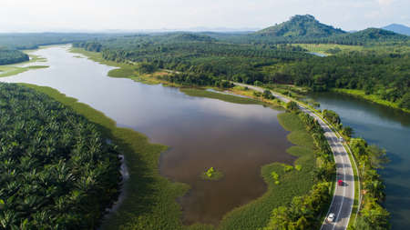 Aerial view of reservoir dam during sunny day. Banco de Imagens