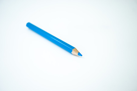 Blue color pencil color isolated on white background. Selective focus. Banco de Imagens