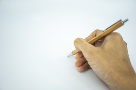 Hand holding mechanical pencil pointing on white paper. Selective focus.