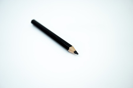 Black color pencil color isolated on white background. Selective focus. Banco de Imagens