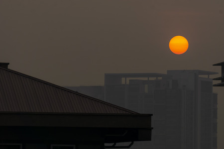 Yellow orange color sun rise behind the building. Banco de Imagens