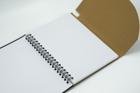 White open notebook isolated on white background. Selective focus.