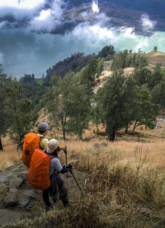 men enjoying view at mountain rinjani indonesia