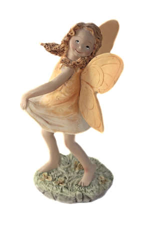 Toy fairy on the grass with flowers Stock Photo