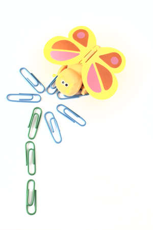 toy butterfly and paper clips flower Stock Photo
