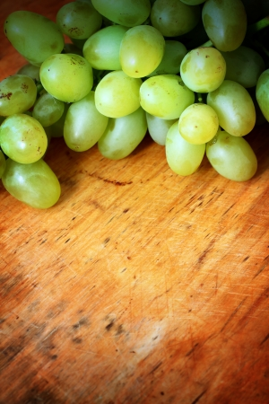 Green grapes on wooden background Stock Photo - 16776441