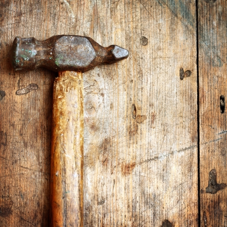tools construction: Old hammer on wooden background Stock Photo