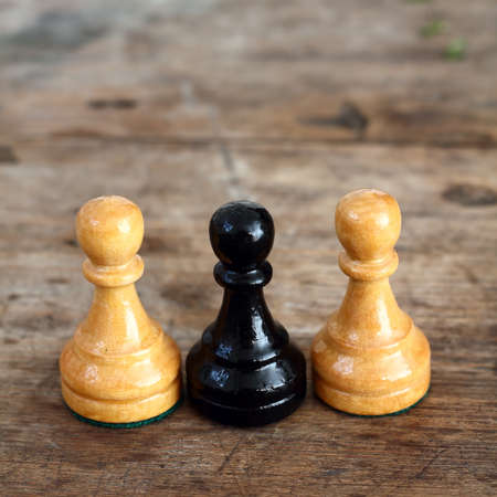 Chess on wooden background Stock Photo