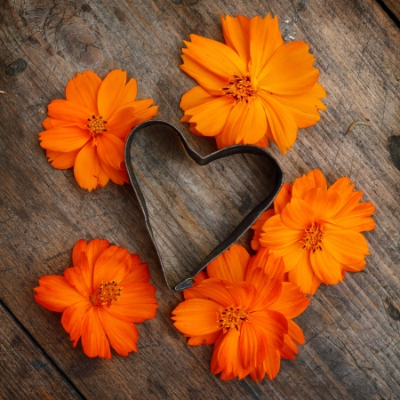 Vintage heart with orange flowers photo