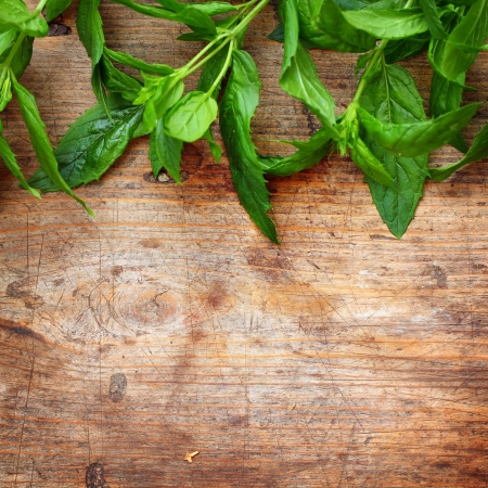 Green mint leaves on wooden background Stock Photo - 16776431