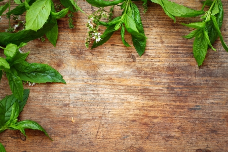 Green mint leaves on wooden background Stock Photo - 16776487