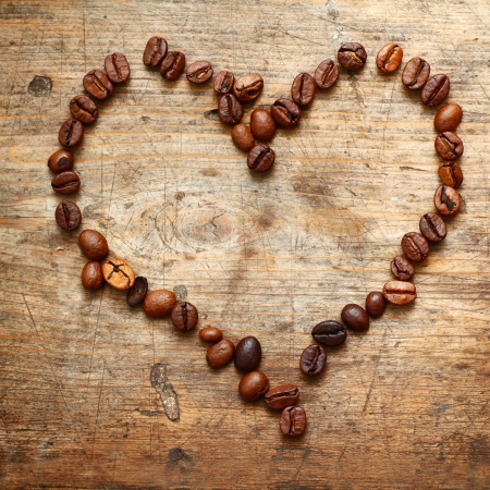 Coffe heart on old wooden background photo