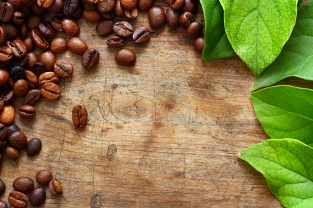 instant coffee: Coffee on wooden background with green leaves Stock Photo