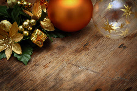 Christmas background with decorations on wooden table