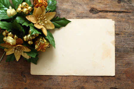 Antique postcard with Christmas decorations on wooden background photo