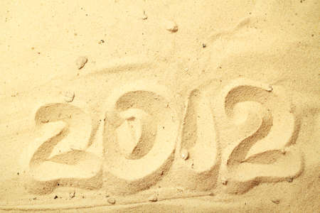 Sand background with 2012 number Stock Photo - 16776492