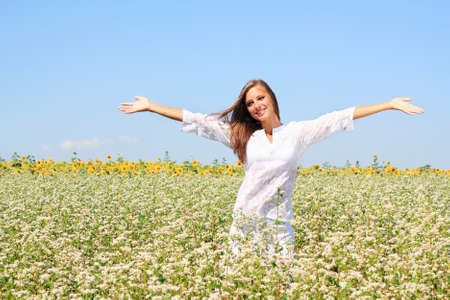 Happy woman in beauty field with white flowers Stock Photo - 17895243