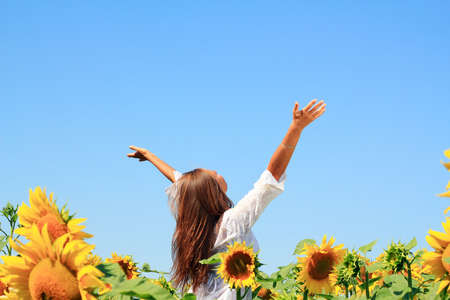 Happy woman in beauty field with sunflowers Stock Photo