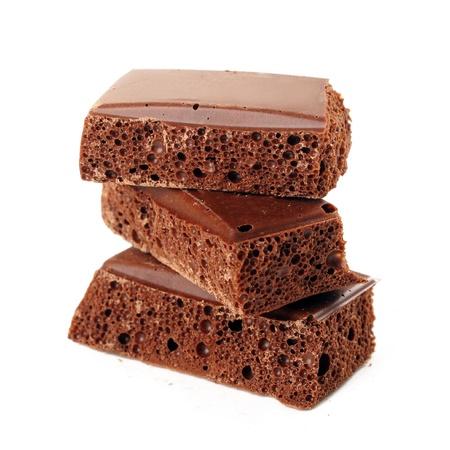porous: Porous chocolate on white background