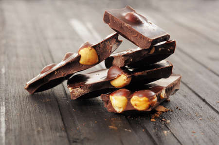 Chocolate with nuts on wooden background Stock Photo