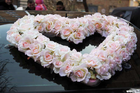 Heart made of roses on wedding car