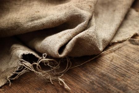 Burlap textile on wooden background