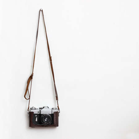 Old camera over white wall