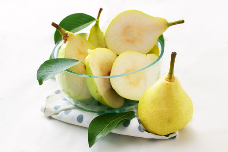 Fresh pears on white background