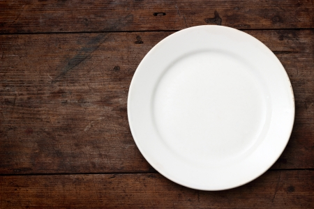 Empty white plate on wooden background Stock Photo