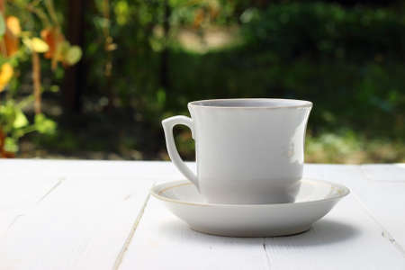 Cup of tea on white table photo