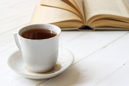 Cup of tea and open book