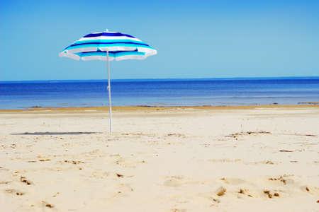 Sun umbrella on sunny beach