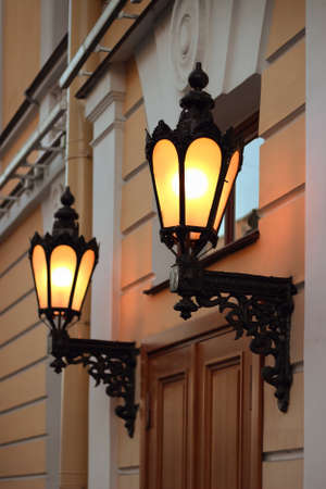 Old lanterns on the wall, Saint Petersburg, Russia photo