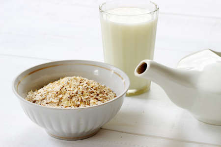 Oatmeal and milk on white background
