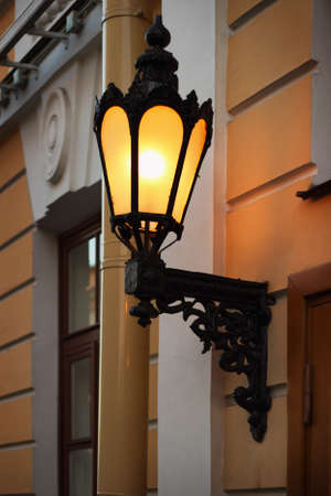 Old lantern on the wall, Saint Petersburg, Russia photo