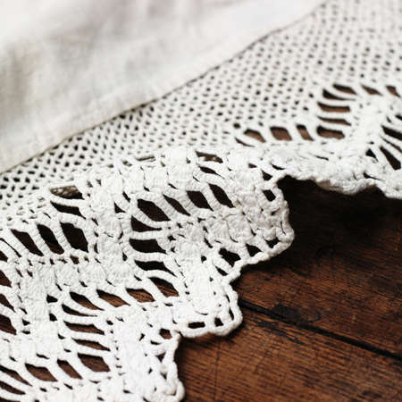weaved: Weaved tablecloth on wooden background