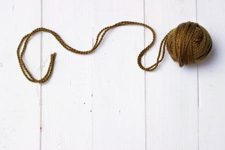 ravel: Thread ravel on white wooden background