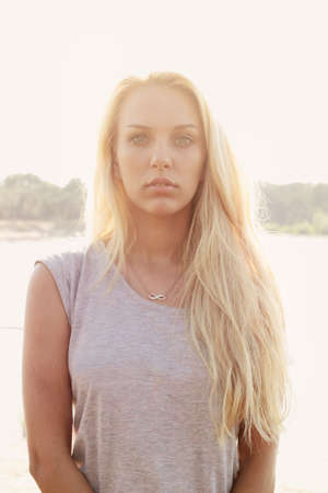 Portrait of young blonde woman in evening sunlight Stock Photo