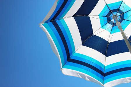 Sun umbrella over blue sky Stock Photo - 31834523
