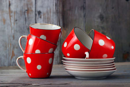 Red cups on wooden background Stock Photo